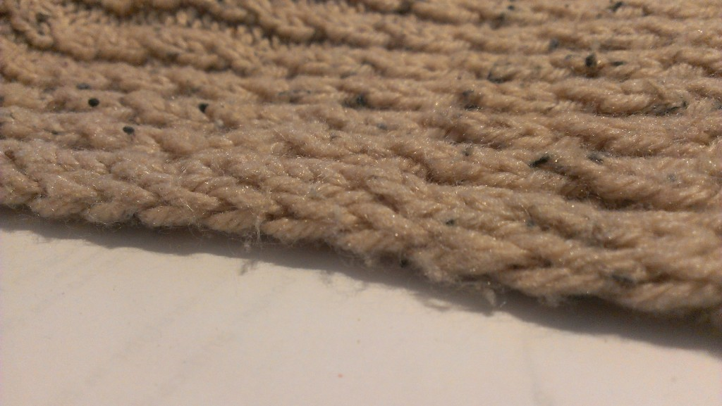 Here's a slipped stitch edge on a poncho thingy I made from Melanie Falick's book, Weekend Knitting. I think that was the first place I, personally, saw this technique.